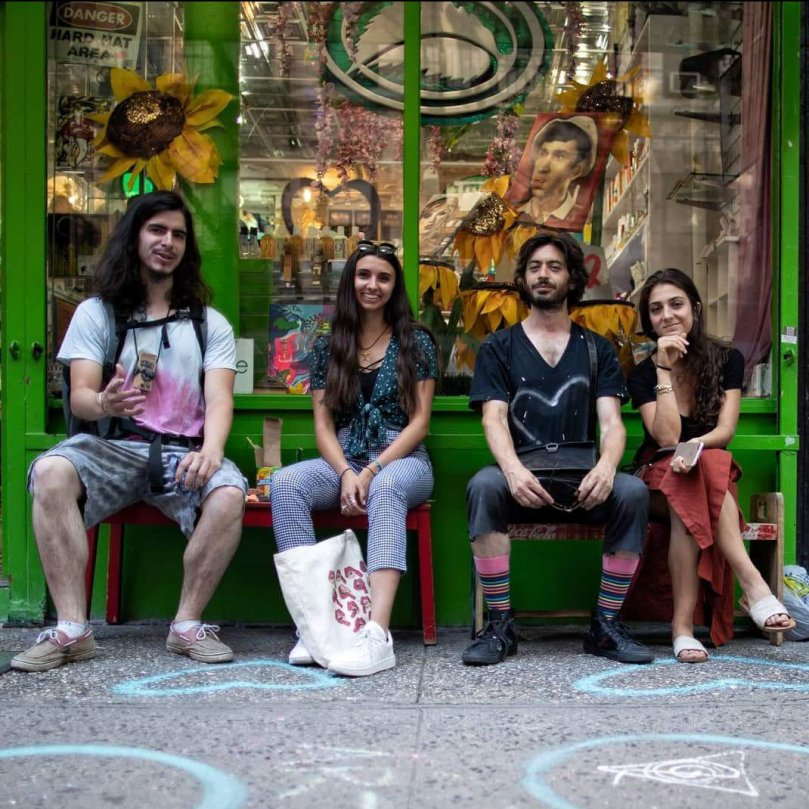 4 young artists sitting in front of Thompson Alchemists