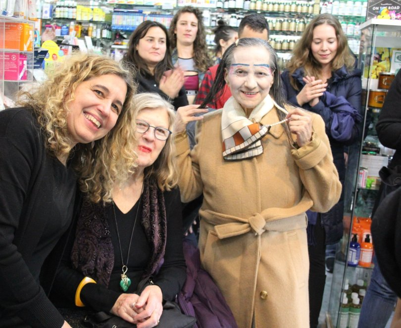 Jolie Alony standing inside Thompson Alchemists and smiling for picture with several of the retail stores customers