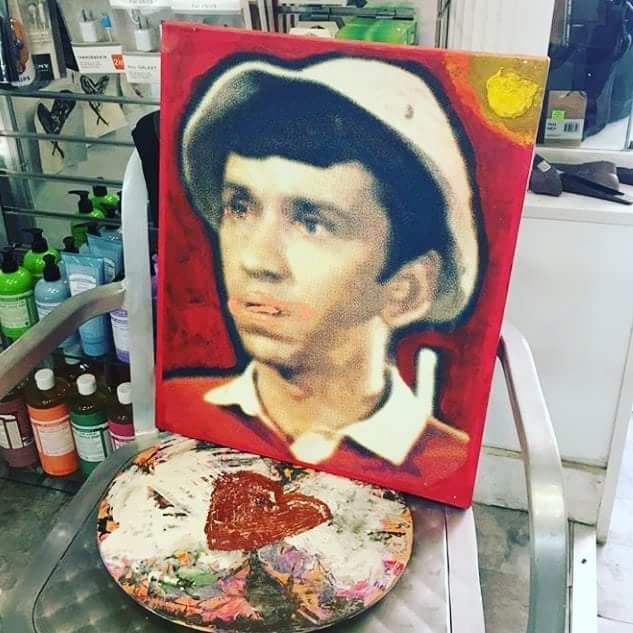 a photo of a picture of Gilligan and a heart painted by Hash Halpern