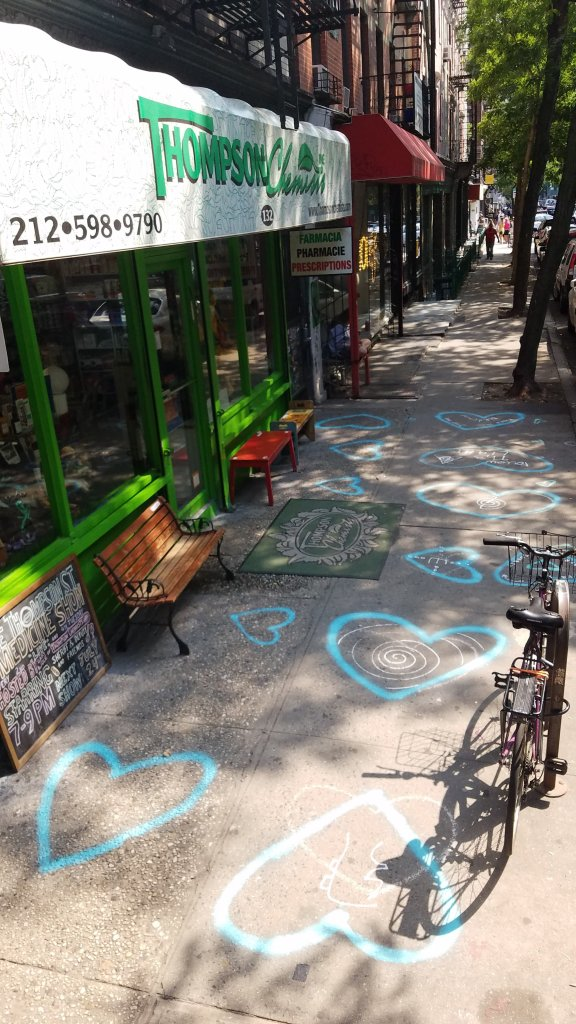 Hash Halpern painted hearts in front of Thompson Alchemists