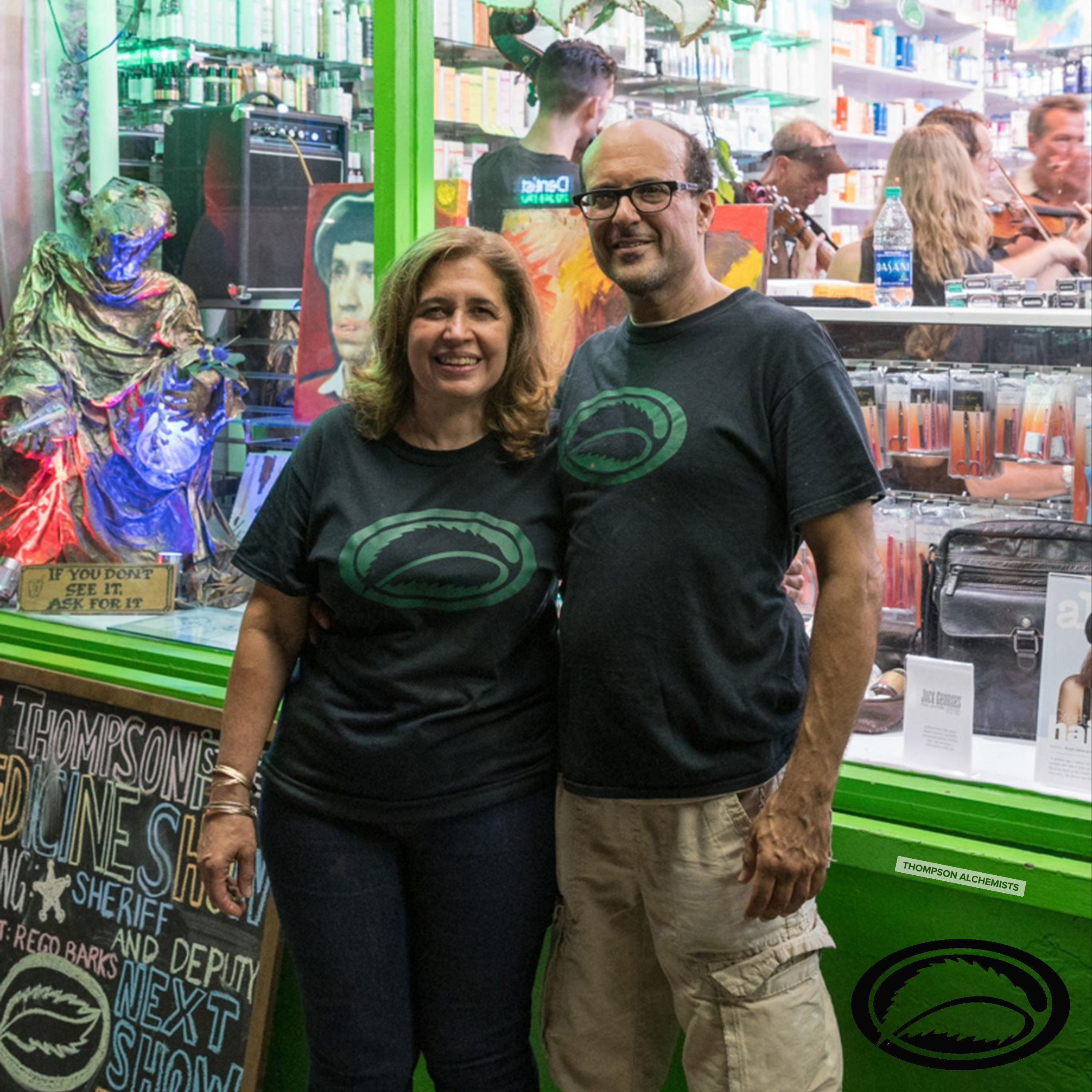 Jolie and Gary Alony, aka, Mama J and the medicine man, standing in front of Thompson Alchemists, Soho, NYC, Thompson Street Medicine Show in the background