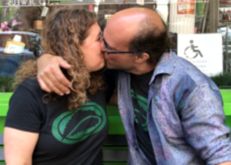 Gary and Jolie Alony, Mama J and The Medicine Man, kissing infront of their Soho NYC retail store